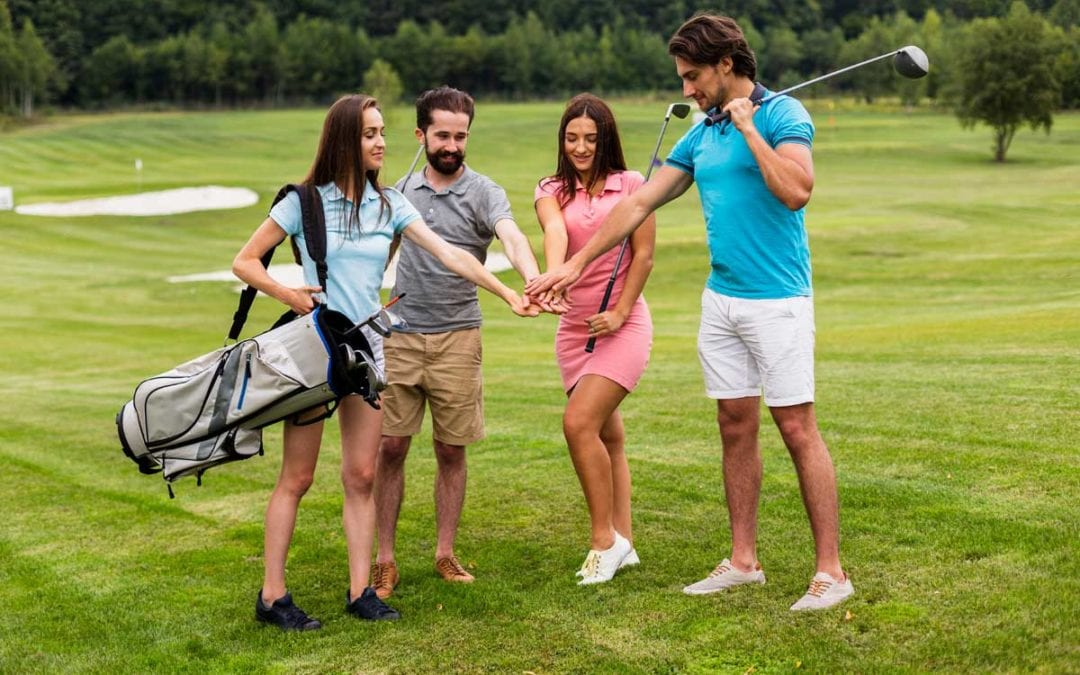 a group of friends on a golf course
